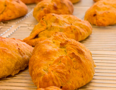image of pasties cooling on a rack